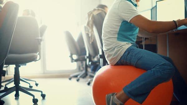 sitting on pilates ball